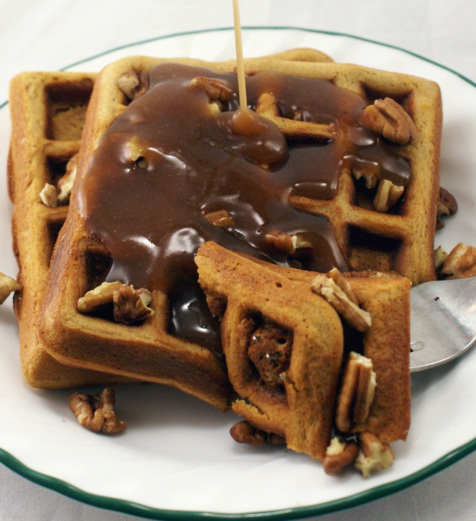 Gingerbread Waffles with Cinnamon-Orange Syrup and Chopped Pecans